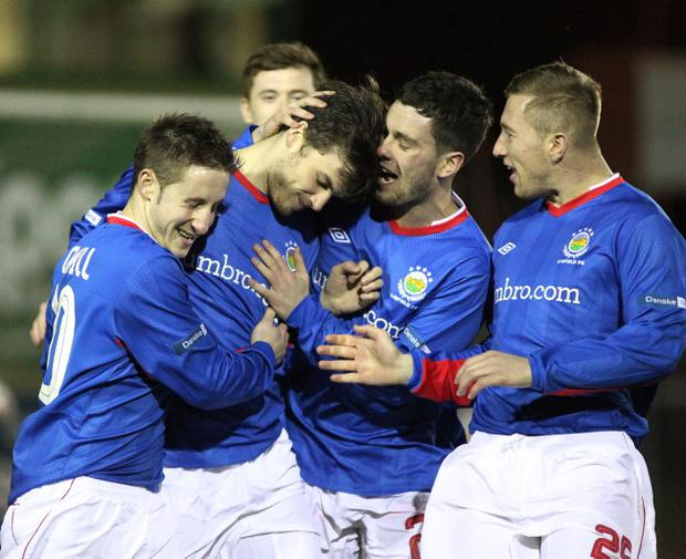 Philip Lowry is congratulated by Michael Carvill, Brian McCaul and Mark McAllister after scoring the opening goal