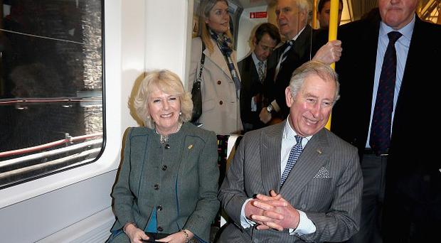 The Duchess of Cornwall and the Prince of Wales travel on a Metropolitan Underground train from Farringdon to King's Cross