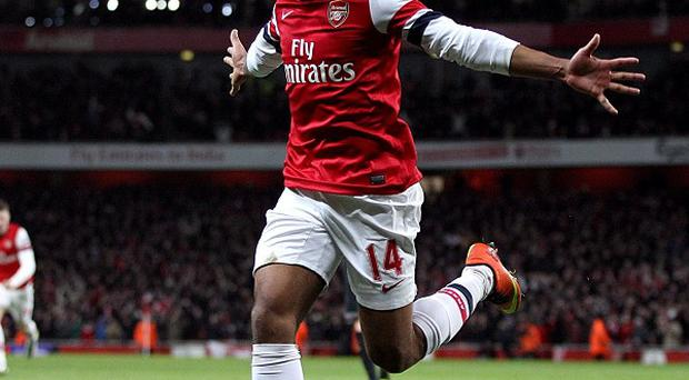 Theo Walcott grabbed the equaliser as Arsenal fought back from two down