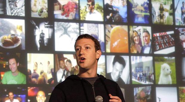 Facebook CEO Mark Zuckerberg, whose firm's shares dipped lower in extended trading (AP)