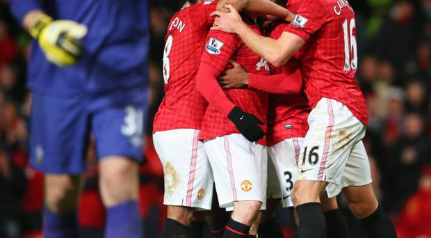 MANCHESTER, ENGLAND - JANUARY 30: Wayne Rooney of Manchester United celebrates with team mates as he scores their second goal during the Barclays Premier League match between Manchester United and Southampton at Old Trafford on January 30, 2013 in Manchester, England. (Photo by Alex Livesey/Getty Images)