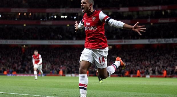 Arsenal's Theo Walcott celebrates scoring his teams second goal of the game during the Barclays Premier League match at the Emirates Stadium