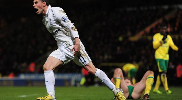 NORWICH, ENGLAND - JANUARY 30: Gareth Bale of Spurs celebrates his goal during the Barclays Premier League match between Norwich City and Tottenham Hotspur at Carrow Road on January 30, 2013 in Norwich, England. (Photo by Jamie McDonald/Getty Images)
