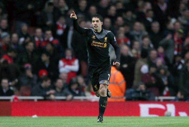 Liverpool's Luis Suarez celebrates scoring his teams first goal of the game during the Barclays Premier League match at the Emirates Stadium