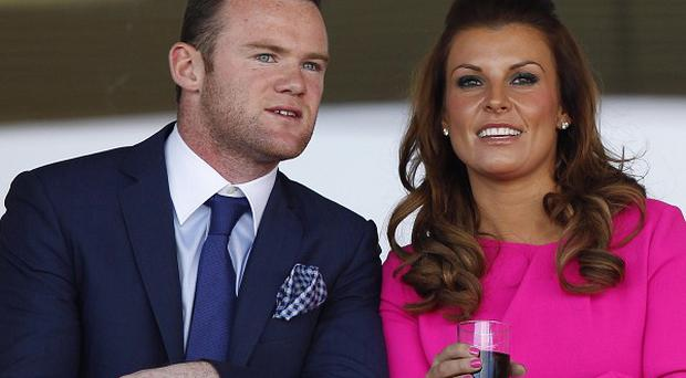 An escort has apologised to Coleen Rooney for kiss-and-tell revelations involving her husband Wayne