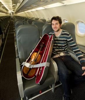 Michael Trainor travels with the £75,000 violin to Belfast on a flight from London