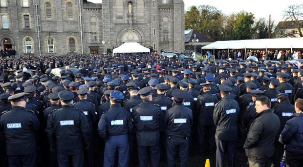 Garda colleagues stand in silence at the funeral of Garda Adrian Donohue