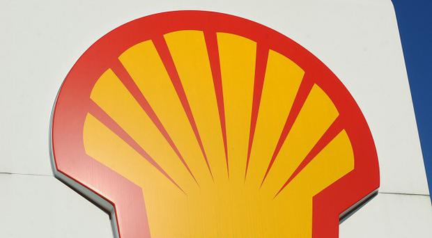 Royal Dutch Shell blamed a decline in earnings on higher costs and exploration expenses