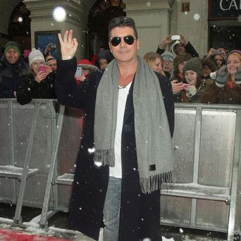 A spokesman for Simon Cowell has denied he uses a booster seat on BGT, saying it is just a 'cushion'