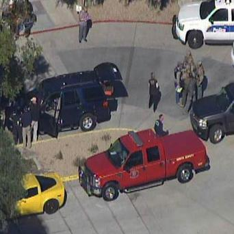 The scene at a Phoenix office complex where police say someone shot at least three people (AP Photo/abc15.com)