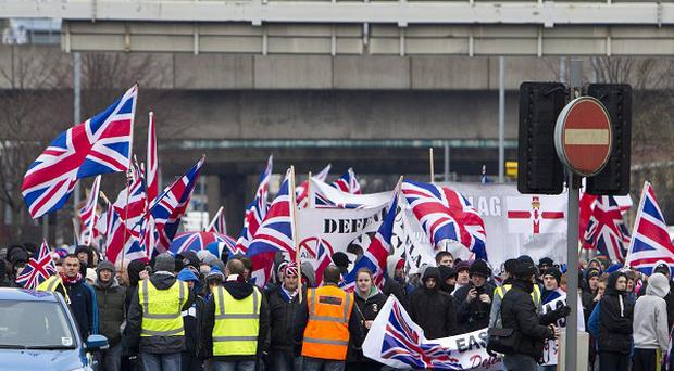 Flag protests in Belfast City Centre have cost bus firms around 50,000 pounds in lost fares