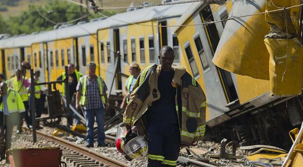 Emergency workers at the scene of the collision between two passenger trains near Pretoria (AP)