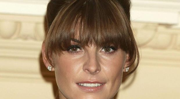 Coleen Rooney was pregnant when kiss-and-tell claims were made against husband Wayne