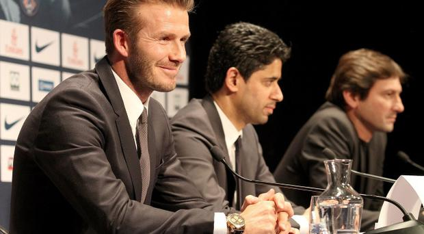 PARIS, FRANCE - JANUARY 31: International soccer player David Beckham, Nasser Al-Khelaifi and Leonardo attend the PPress conference for his PSG signature at Parc des Princes on January 31, 2013 in Paris, France. (Photo by Marc Piasecki/Getty Images)