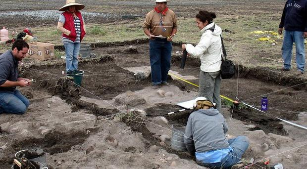Archaeologists work at the site where skulls were found in Xaltocan, near the Teotihuacan pyramids in central Mexico (AP/Christopher Y Morehart)