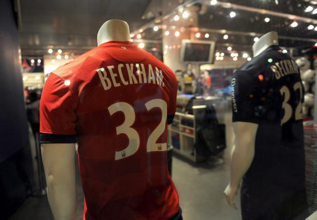 David Beckham shirts are seen on sale in the gift shop at Parc des Princes, Paris