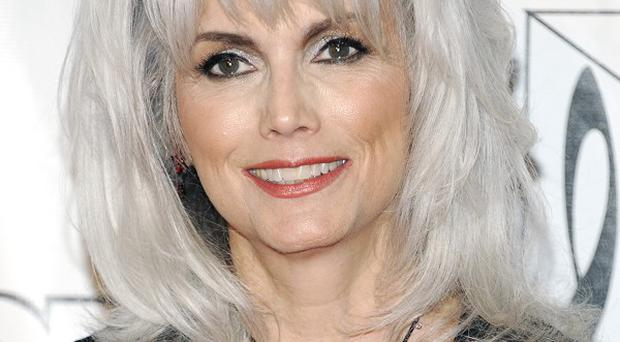 Emmylou Harris is accused of failing to exchange information with a driver whose car she hit on a freeway (Evan Agostini/Invision/AP)