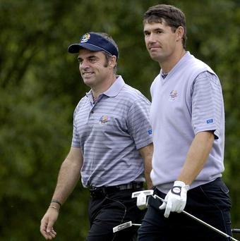 Padraig Harrington, right, has hailed the appointment of Paul McGinley, left, as Ryder Cup captain