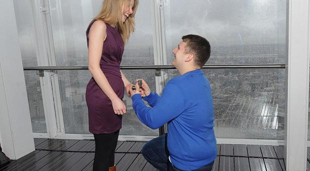 James Episcopou, 22, proposes to his girlfriend Laura Taylor, 22, at The View at the Shard building in London