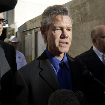 Randy Travis has pleaded guilty to drink-driving