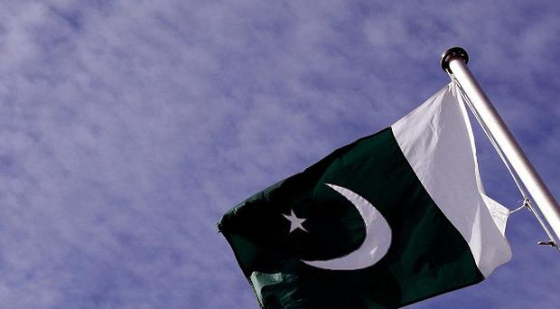Bombers have targeted worshippers at a mosque in north-west Pakistan