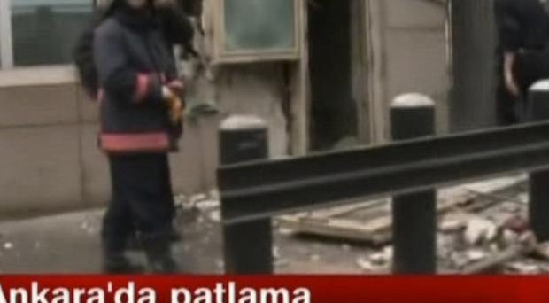 In this image made from video, emergency personnel are seen in front of a side entrance to the US embassy in Ankara following the blast (AP /NTV)