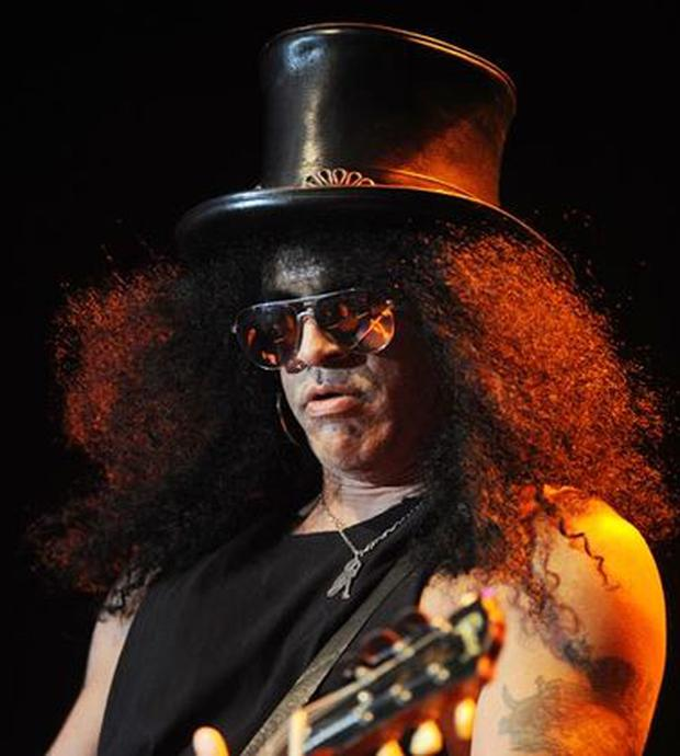 Guns 'n' Roses guitarist Slash is never on stage without this oversized black leather top hat.