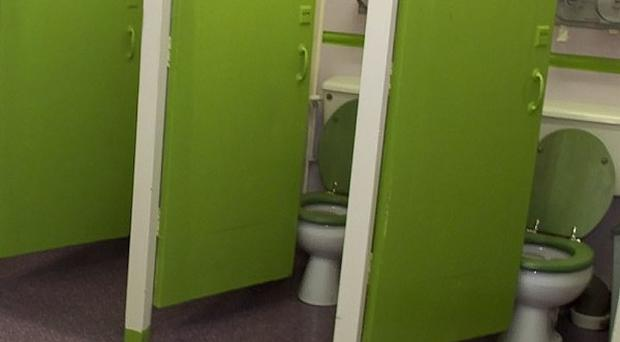 Councils must provide sanitary bins in more public toilets, a local charity has said