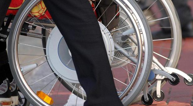Wheelchair user threatened and told to hand over cash, court heard.