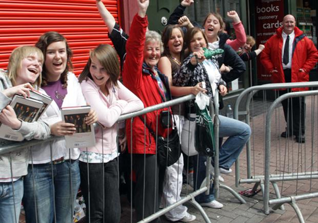 First fans in the queue to see Westlife during their book signing in Belfast