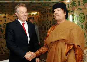 File photo dated 29/05/2007 of former Prime Minister Tony Blair meeting Libyan leader Colonel Muammar Gaddafi at his desert base outside Sirte south of Tripoli