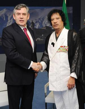 File photo dated 10/07/2009 of former Prime Minister Gordon Brown meets Libyan leader Muammar Gaddafi at the G8 Summit in L'Aquilla