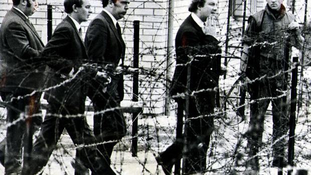 Behind the barbed wire of long kesh internment camp   are SDLP  MPs(from left)Paddy Devlin, Austin Currie, John Hume and Ivan Cooper. They were visiting internees. 21/09/71