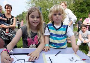 22nd May 2010.  Children's festival in the Waterworks in north Belfast.  Left to right.  Molley Agnew Boyce(9) from Fortwilliam and Ted Anderson(2) from Holywood play with a device which makes sounds as they draw.