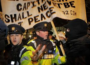 Gardai scuffle with masked youths as crowds gather to voice their opposition at Leinster House in Dublin