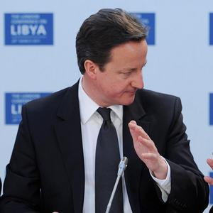 Britain has not ruled out arming opposition forces in Libya, Prime Minister David Cameron said