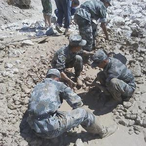 Rescuers search for missing people in Zhouqu county after landslides and flooding triggered by heavy rain killed at least 120 people. (AP)