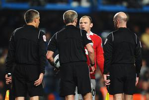 LONDON, ENGLAND - MARCH 01:  Wayne Rooney of Manchester United exchanges words with referee Martin Atkinson after the Barclays Premier League match between Chelsea and Manchester United at Stamford Bridge on March 1, 2011 in London, England.  (Photo by Clive Mason/Getty Images)