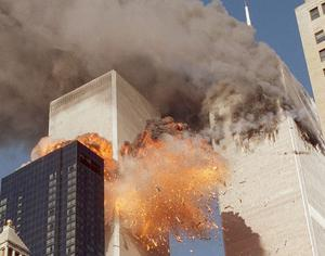 Smoke billows from one of the towers of the World Trade Center and flames as debris explodes from the second tower, in this Sept. 11, 2001