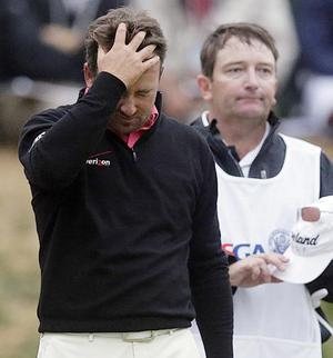 Dejected: Graeme walks off the 18th knowing it's all over
