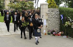 PEDRENA, SPAIN - MAY 11:  A bagpipe player leads relatives and friends as they leave with an urn containing the ashes of Seve Ballesteros to attend the funeral service held for the legendary Spanish golfer on May 11, 2011 in Pedrena, Spain. Top-ranked golf players have joined family members and friends to pay their last respects to the late golf great, who died on May 7, 2011 from complications arising from a brain tumor, in his home town parish church.  (Photo by David Ramos/Getty Images)