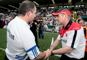 Tyrone manager Mickey Harte shakes hands with Monaghan manager Seamus McEnaney