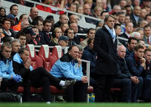 LONDON, ENGLAND - APRIL 08:  Man City manager Roberto Mancini and assistant coach David Platt look on  during the Barclays Premier League match between Arsenal and Manchester City at Emirates Stadium on April 8, 2012 in London, England.  (Photo by Michael Regan/Getty Images)