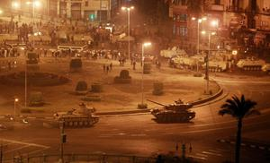 CAIRO, EGYPT - JANUARY 28:  Army tanks line up in Tahrir Square on January 28, 2011 in Cairo, Egypt.Thousands of police are on the streets of the capital. Hundreds of arrests have been made in an attempt to quell demonstrations.  (Photo by Peter Macdiarmid/Getty Images)