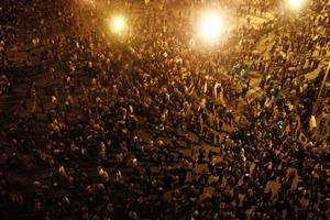 In this photo released by China's Xinhua News Agency, anti-government demonstrators protest in Cairo, capital of Egypt, on Friday, Jan. 28, 2011. Protesters have seized the streets of Cairo, battling police with stones and firebombs, burning down the ruling party headquarters, and defying a night curfew enforced by a military deployment.