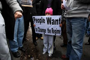 A young girl holds a sign as she joins protesters outside the Egyptian Embassy in Dublin, in a show of solidarity with thousands of anti-government activists in Cairo and other cities.