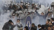 Egyptian anti-government activists clash with riot police in Cairo, Egypt, Friday, Jan. 28, 2011. Tens of thousands of anti-government protesters poured into the streets of Egypt Friday, stoning and confronting police who fired back with rubber bullets and tear gas in the most violent and chaotic scenes yet in the challenge to President Hosni Mubarak's 30-year rule. One protester was killed and even a Nobel Peace laureate was placed under house arrest after joining demonstrations.