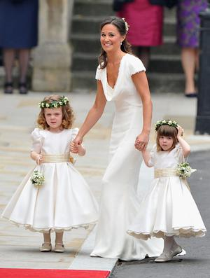 LONDON, ENGLAND - APRIL 29:  Sister of the bride and Maid of Honour Pippa Middleton holds hands with Grace Van Cutsem and Eliza Lopes as they arrive to attend the Royal Wedding of Prince William to Catherine Middleton at Westminster Abbey on April 29, 2011 in London, England. The marriage of the second in line to the British throne is to be led by the Archbishop of Canterbury and will be attended by 1900 guests, including foreign Royal family members and heads of state. Thousands of well-wishers from around the world have also flocked to London to witness the spectacle and pageantry of the Royal Wedding.  (Photo by Pascal Le Segretain/Getty Images)