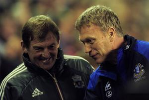 LIVERPOOL, ENGLAND - MARCH 13:  Liverpool manager Kenny Dalglish and Everton manager David Moyes speak ahead of the Barclays Premier League match between Liverpool and Everton at Anfield on March 13, 2012 in Liverpool, England.  (Photo by Jamie McDonald/Getty Images)