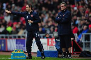 SUNDERLAND, ENGLAND - DECEMBER 11:  New Sundeland manager Martin O' Neill (l) and assistant Steve Walford react during the Barclays premier league game between Sunderland and Blackburn Rovers at Stadium of Light on December 11, 2011 in Sunderland, England.  (Photo by Stu Forster/Getty Images)